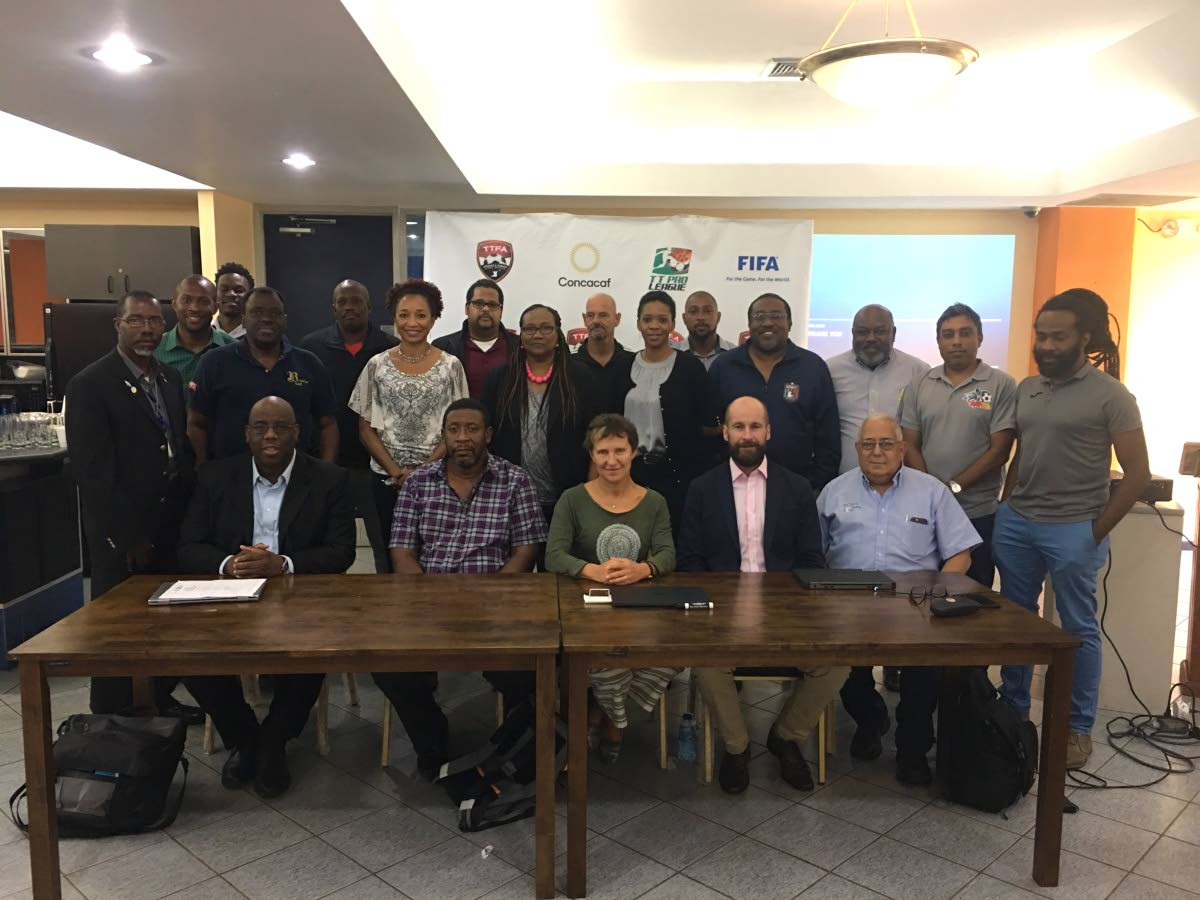 FULL SUPPORT: (Seated, left to right) Howard McIntosh, ONE CONCACAF and Caribbean Projects senior manager, TT Football Association president David John-Williams, Eva Pasquier, head of international relations at UEFA, UEFA ASSIST's Kenny MacLeod and TT Pro League chairman Richard Fakoory, are joined by other TT football stakeholders at the end of a three-day UEFA ASSIST workshop, Road to Strategic Planning for the Pro League, at the Faculty of Social Sciences of the University of the West Indies, St. Augustine Campus, Thursday.