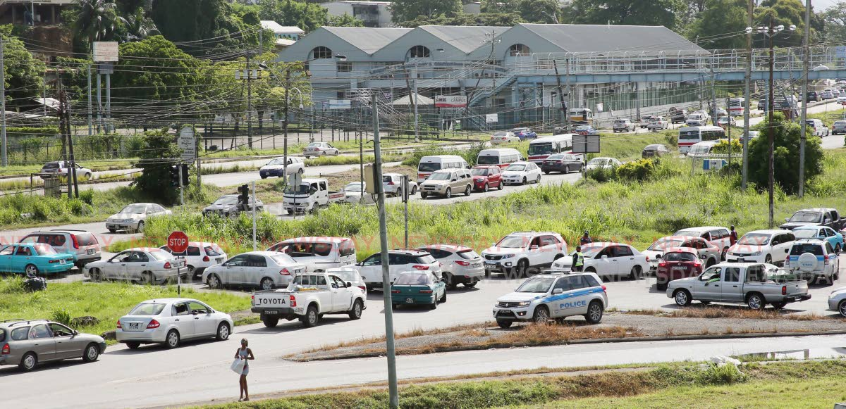 Traffic is bumper to bumper as drivers filter out of Port of Spain Priority along the Priority Bus Route and Eastern Main Road due to the closure of the Churchill Rosevelt Highway, from Barataria to Port of Spain, for dredging works on the Beetham river and the installation of the Sea Lots walkover today. PHOTO BY AZLAN MOHAMMED