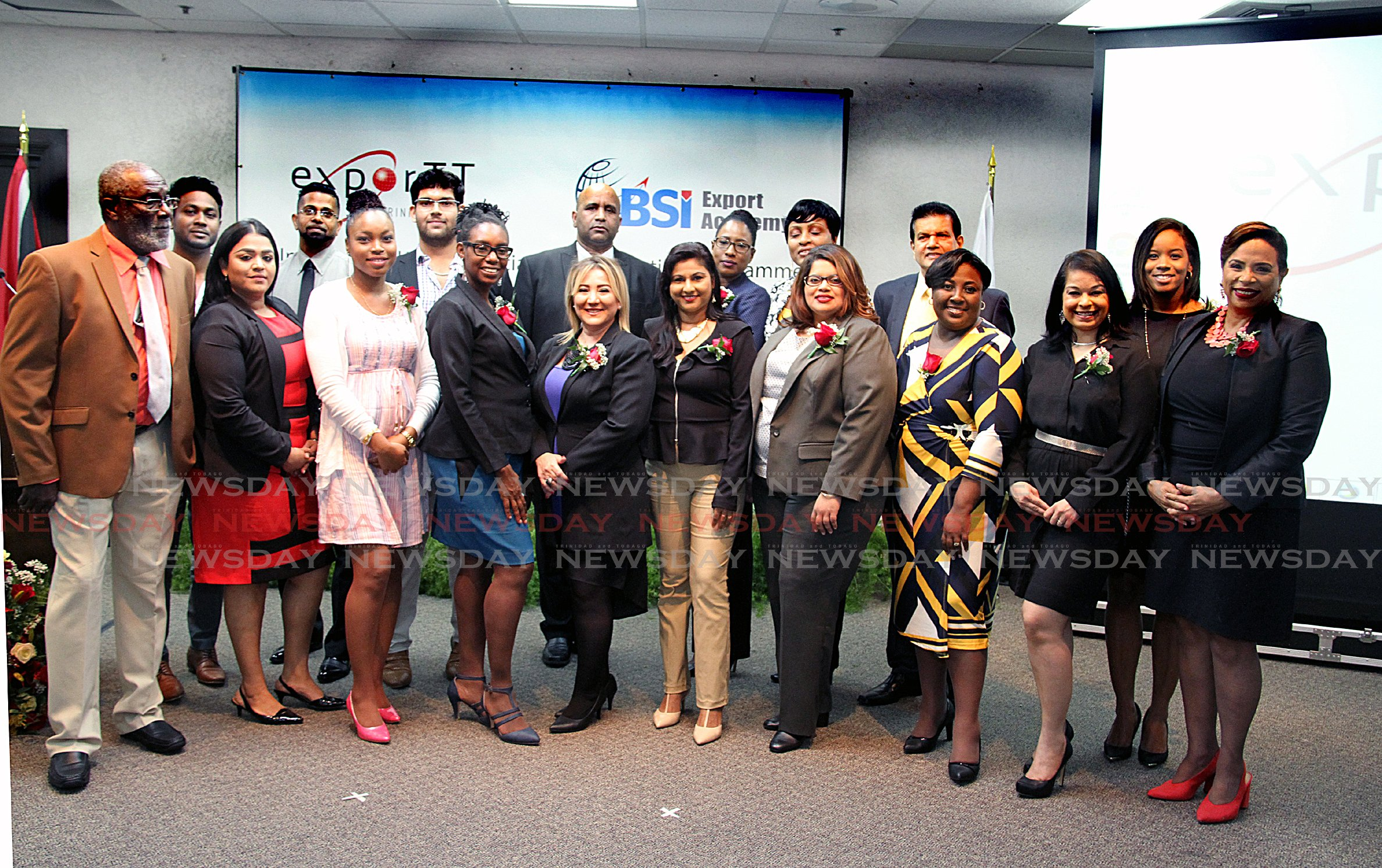 Class of 2017 of the the International Trade Specialist Accreditation Programme of the eBSI Export Academy with exportTT's  CEO Dietrich Guichard middle back row posing for a group photo during their graduation ceremony Friday evening at the Chamber of Commerce building Westmoorings. PHOTO SUREASH CHOLAI
