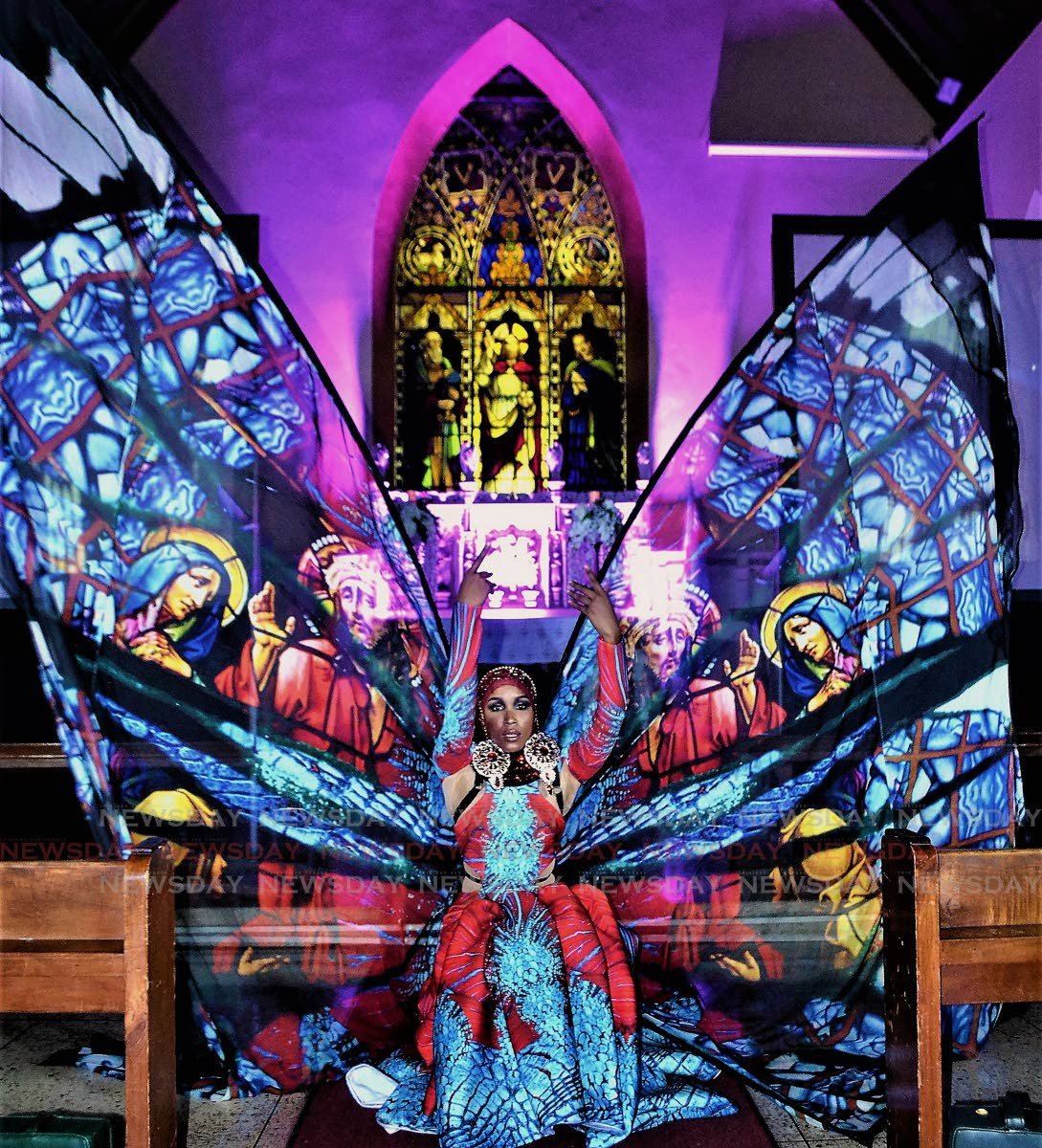 The Divine: Amare spreads her wings across the aisle of All Saints Anglican Church, Port of Spain sharing love in K2K Alliance and Partner's 2019 Christian-centric themed Carnival presentation Through Stained Glass Windows on Friday night.  PHOTOS BY GARY CARDINEZ