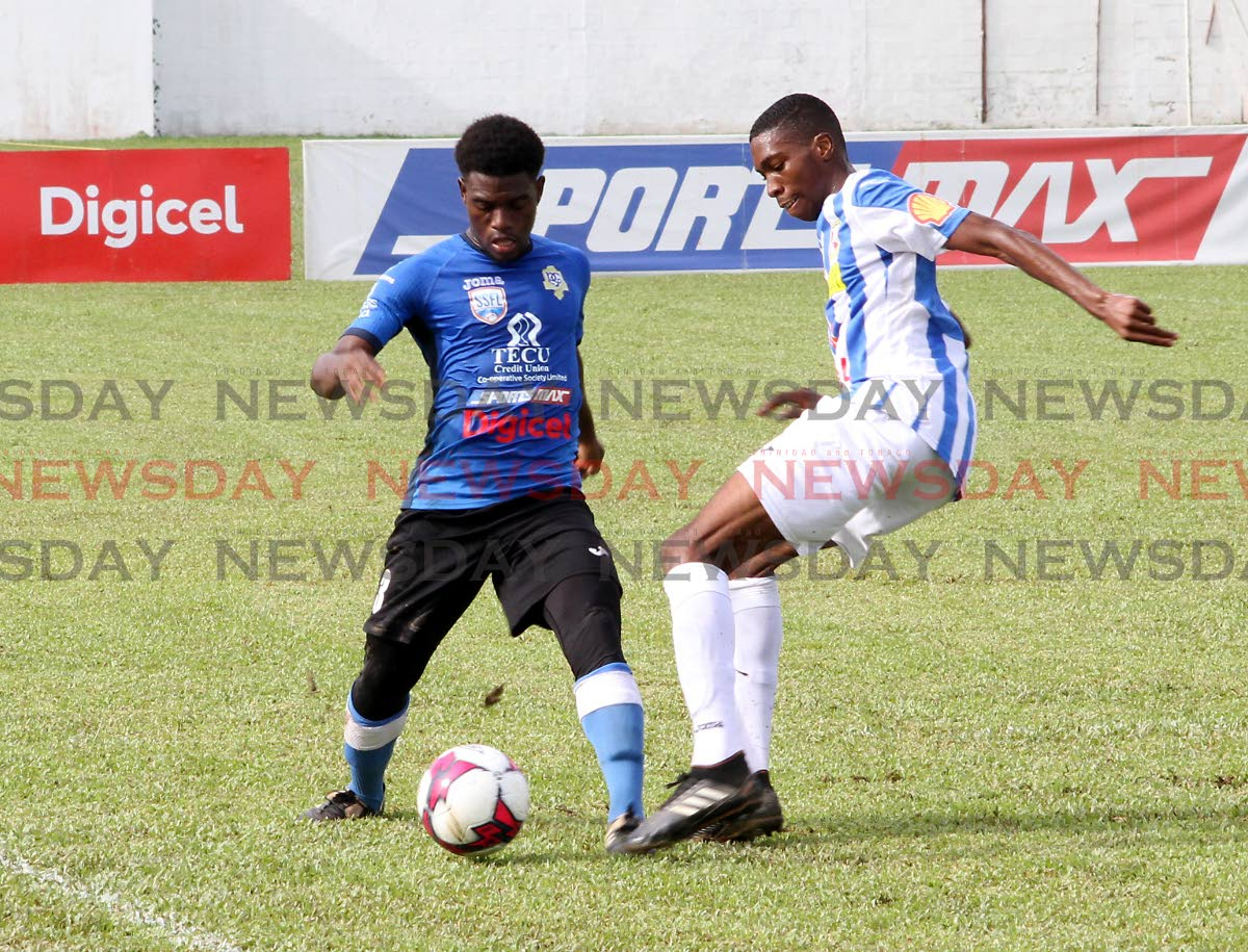 Presentation College's Juaval Roberts, left, takes on St Mary's Tyrese Spicer in a Secondary Schools Football League match yesterday. PHOTO BY ROGER JACOB
