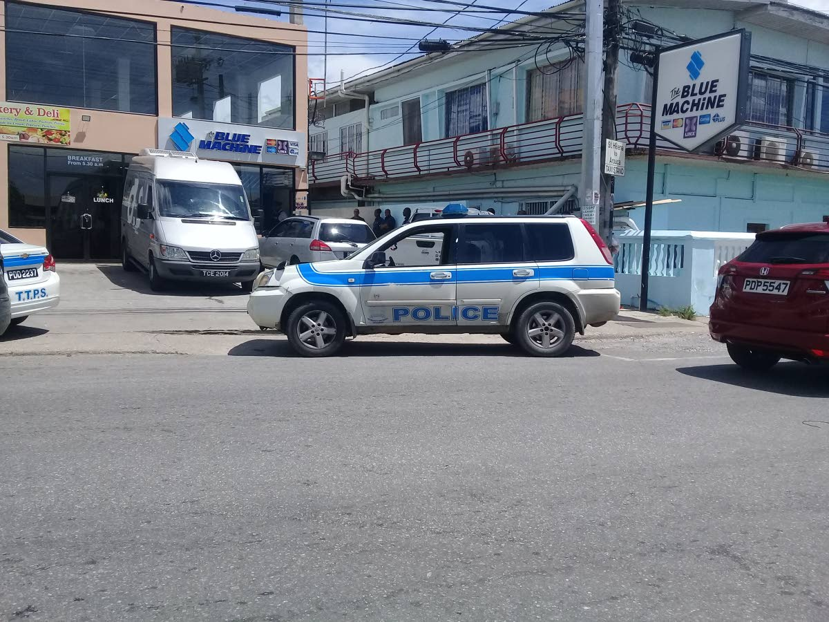 Police arrive at the St Helena Republic Bank branch where three G4Ssecurity guards were robbed of cash and their weapons while trying to replenish an ATM.
