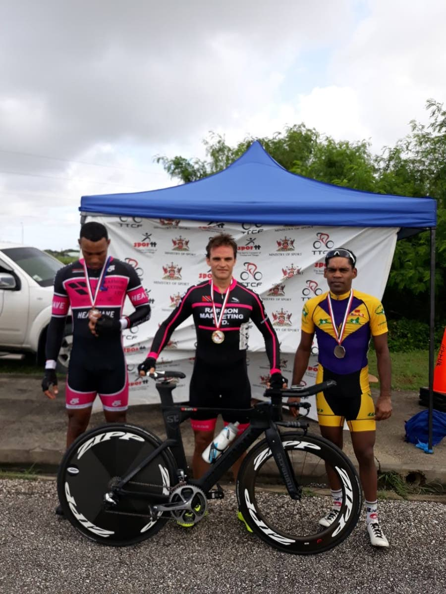 Time trial winner Christopher Govia, centre, second place finisher Sheldon Ramjit, right, and third place finisher Marcus Carvalho.