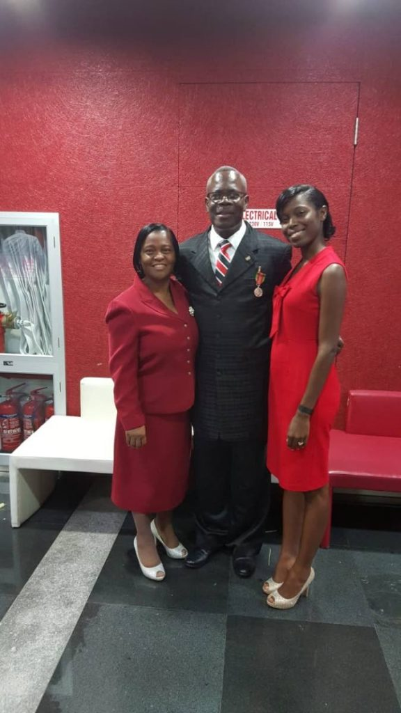 President of the Caribbean Union Conference of Seventh Day Adventists, Dr Kern Tobias, shares the special moment of his receiving a Chaconia Medal (Silver) with his wife, Linda, and daughter, Dr Kerly-Ann Joseph at Monday's National Awards ceremony at the North Academy of the Performing Arts (NAPA) in Port of Spain.