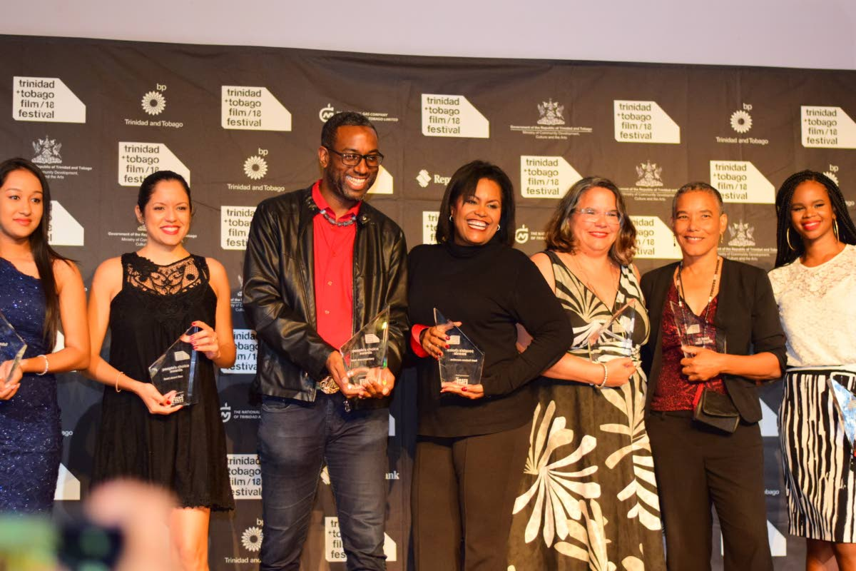 BIG WINNERS: Winners at the Trinidad and Tobago Film Festival 2018 Award Ceremony held at the Central Bank Auditorium on Tuesday Night. From left are Celine Dimsoy, best future critic, Mangroves director Teneille Newallo, Carnival Messiah director Ashley Karrell, Hero executive producer Lisa Wickham, Unfinished Sentences director Mariel Brown, Venus and Magnet director Elspeth Duncan and Caribbean Film Mart Best Pitch winner Kafi Kareem Farrell.