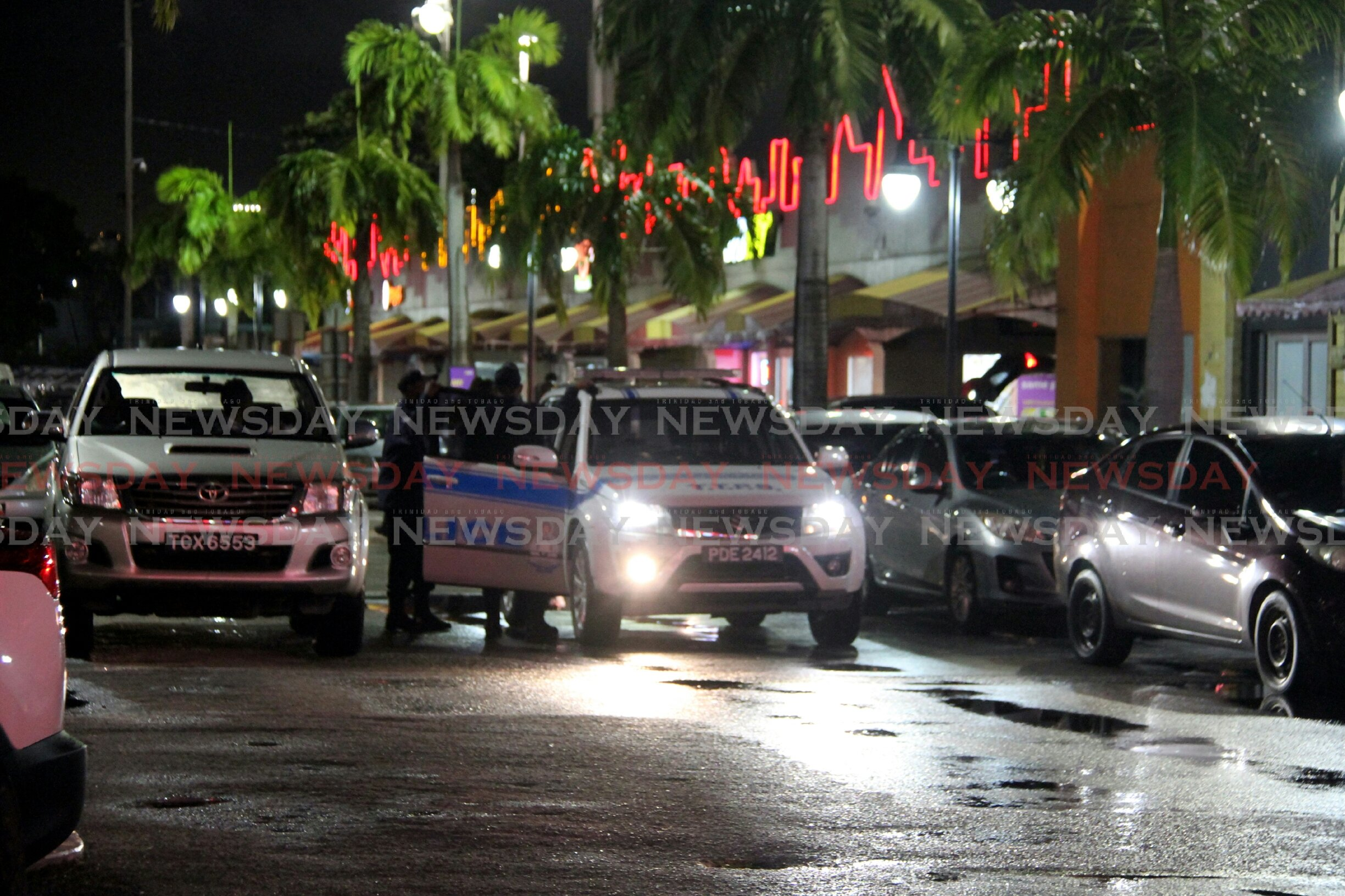 Police at the scene of a shooting at Movietowne, Port of Spain.  Photo by Sureash Cholai