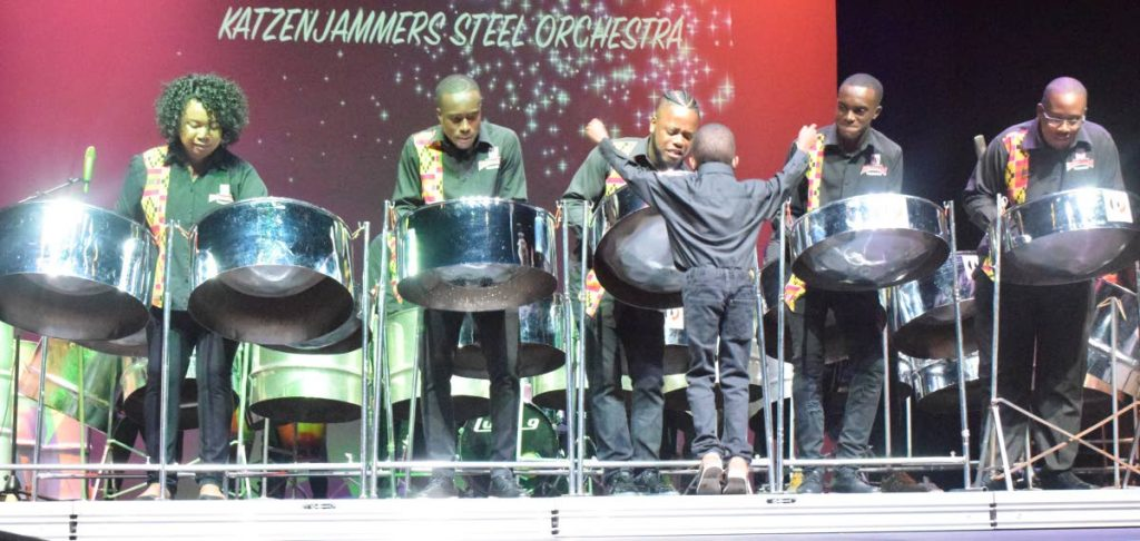 Youngest member of Petrotrin Katzenjammers Steel Orchestra, Jadon Phillip, conducts the band as members performed at the Socalypso Chronicles concert at Shaw Park Cultural Complex earlier this year.