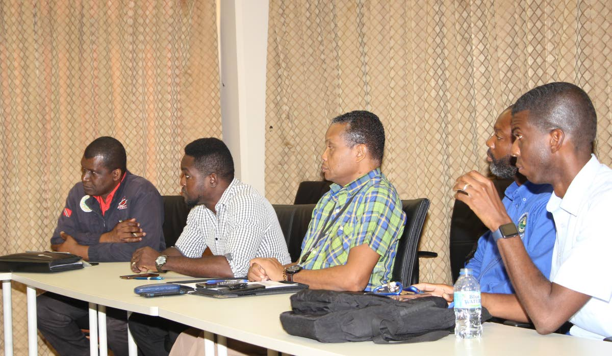 Allan Stewart, left, Director, Tobago Emergency Management Agency at a stakeholders meeting to review Tobago sargassum emergency response plan earlier this year.