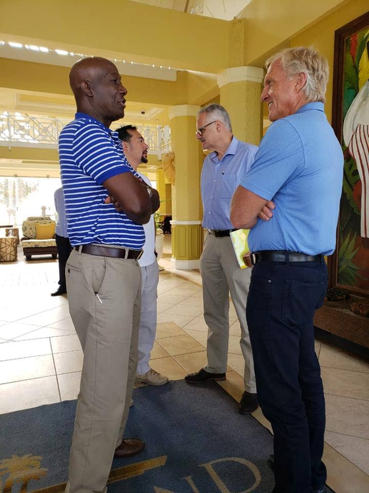 Prime Minister Dr Keith Rowley, left, chats with Sandals consultant, golfer Greg Norman recently during a tour of key sites in Tobago.  In the background, Sandals' CEO Gebhard Rainer, right, chats with National Security Minister Minister Stuart Young.