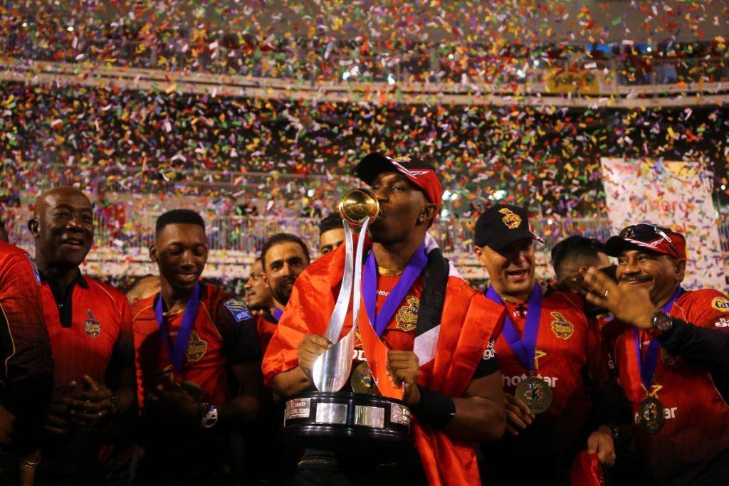 Dwayne Bravo, captain of Trinbago Knight Riders, kisses the trophy during the Hero Caribbean Premier League final between Trinbago Knight Riders and Guyana Amazon Warriors at Brian Lara Stadium on September 16, in Tarouba. (Photo by Ashley Allen - CPL T20)