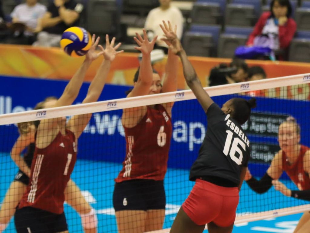 TT's Krystle Esdelle (no16) scores at will pass USA's Micha Hancock (no 1) and Tetori Dixon (no 6) on the second day of the FIVB World Championships yesterday at the Kobe Green Arena, Kobe, Japan