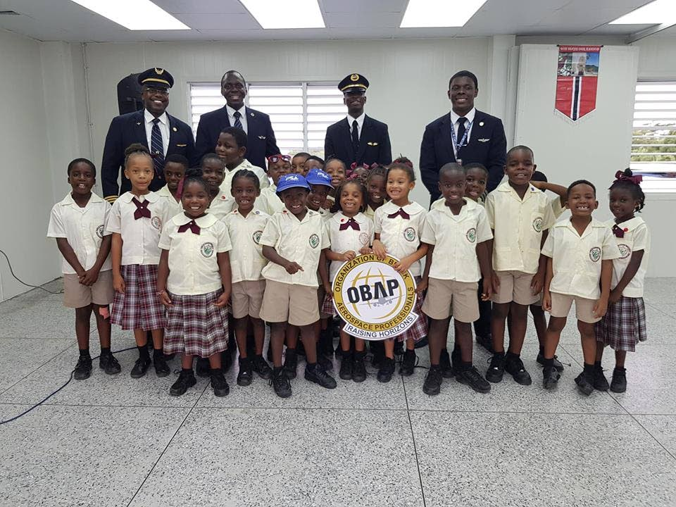 Pupils of the Signal Hill Early Childhood Centre pose for a photo with  pilots from the Organisation of Black Aerospace Professionals (OBAP), including Bethel's own Jerome Lawrence, during a  motivational visit last week.