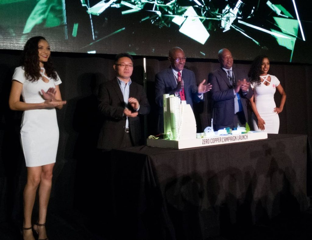 From left, Huawei's Yang Weijun, President, LATAM Carrier Business, Senator Robert Le Hunte and TSTT's Dr Ronald Walcott with Huawei brand hosts at the launch of its Zero Copper campaign at the Hyatt Regency. Photo by Mark Lyndersay.
