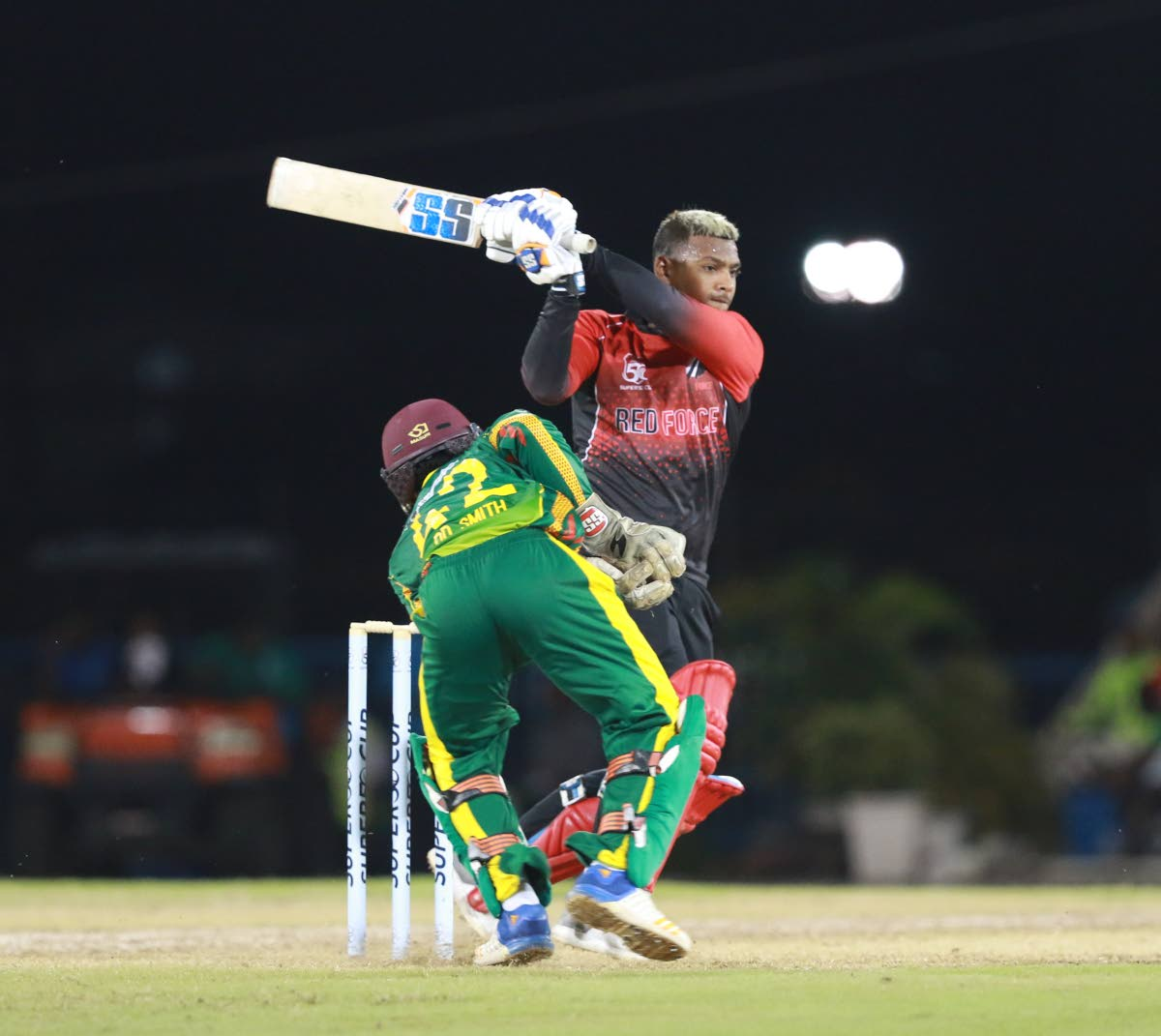 TT Red Force batsman Nicholas Pooran plays a shot during his knock  of 89 runs during the Super 50 match against the Windward Islands at the Queen's Park Oval,on October 3. Image:Nicholas Bhajan/CA-images