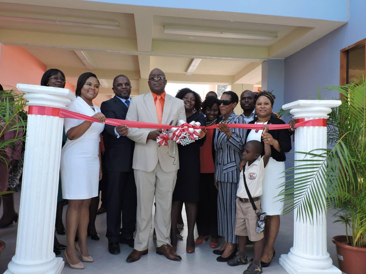 THA Chief Secretary and Secretary of Education, Innovation and Energy Kelvin Charles cuts the ribbon officially commissioning of the Scarborough Roman Catholic School at Smithfield on August 29. Also in photo,from left, are Health Secretary Agatha Carrington, Sports Minister and MP for Tobago West - Shamfa Cudjoe, Finance Secretary Joel Jack, Ag Principal Patricia Wafe, Catholic Education Board of Management representative Agnes Murray and Presiding Officer of the THA Legislature, Denise Tsoiafatt-Angus.