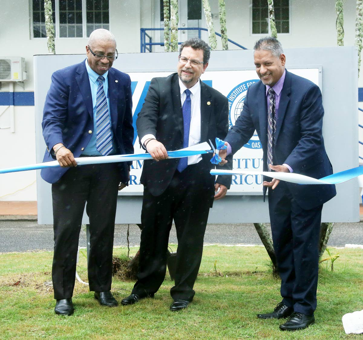 Minister of Agriculture Clarence Rambharat cuts the ribbon with IICA director of management and regional integration Diego Montenegro, centre, and IICA TT representative Gregg C E Rawlins at the opening of the institute's office, Brechin Castle, Couva on Tuesday.