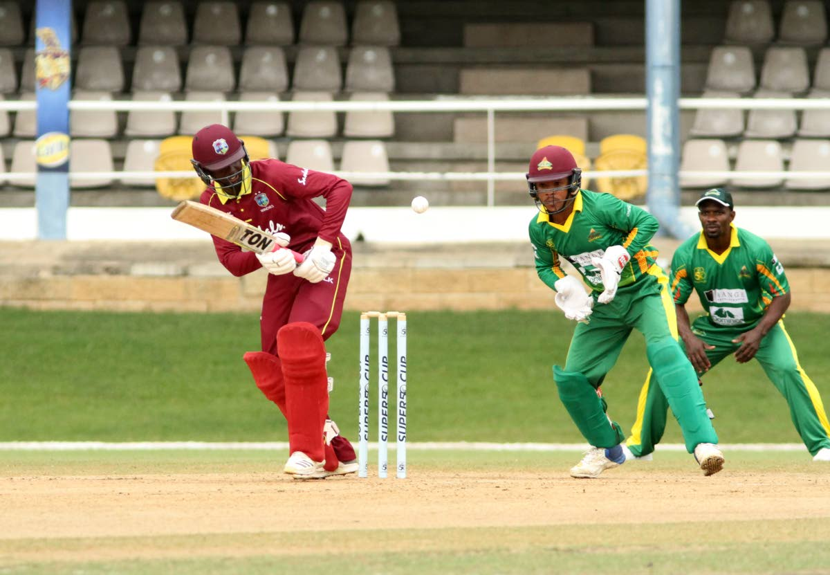 West Indies B opening batsman Kimani Melius plays a shot to the leg-side during his innings of 33 against the Windward Islands Volcanoes yesterday.