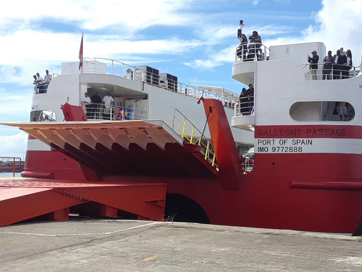 Passengers on board the Galleons Passage look on as the ferry docks in the Scarborough port of Monday on its first official sailing on the sea bridge.