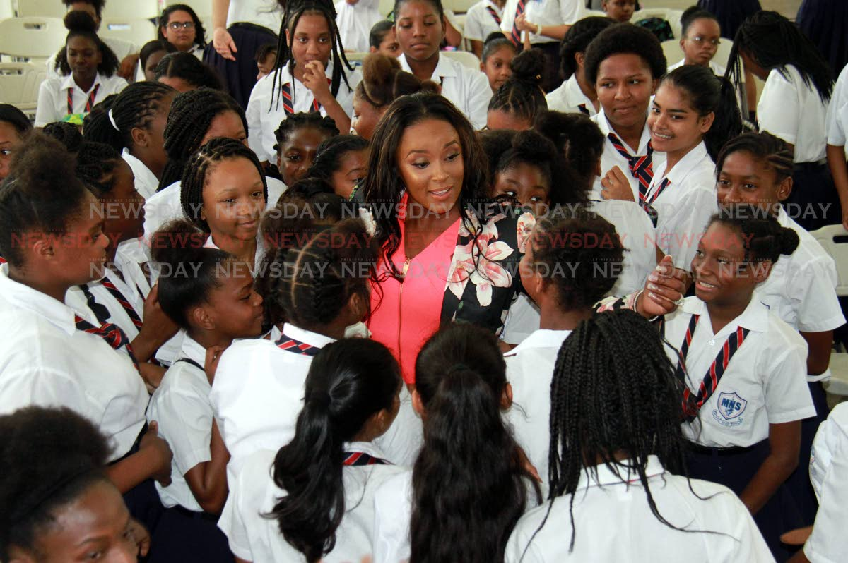 At center, Nicole Dyer Griffith is surrounded by students of the Marabella North Secondary School during a programme for International Day of the Girl Child at the school in Marabella. PHOTO BY ANIL RAMPERSAD.