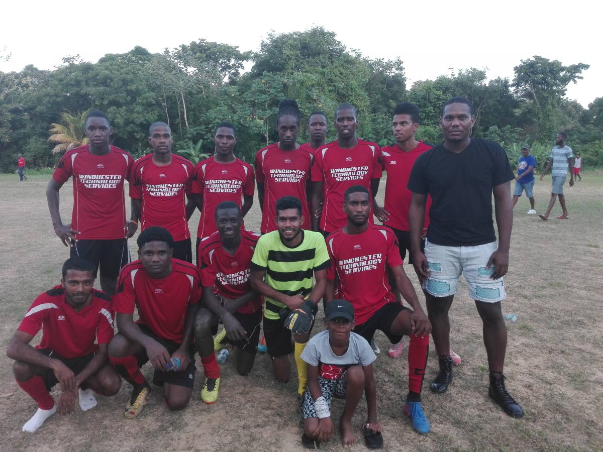 G Madrid players, fans and manager after a win earlier this season in the Caribbean Welders Fishing Pond Football League.
