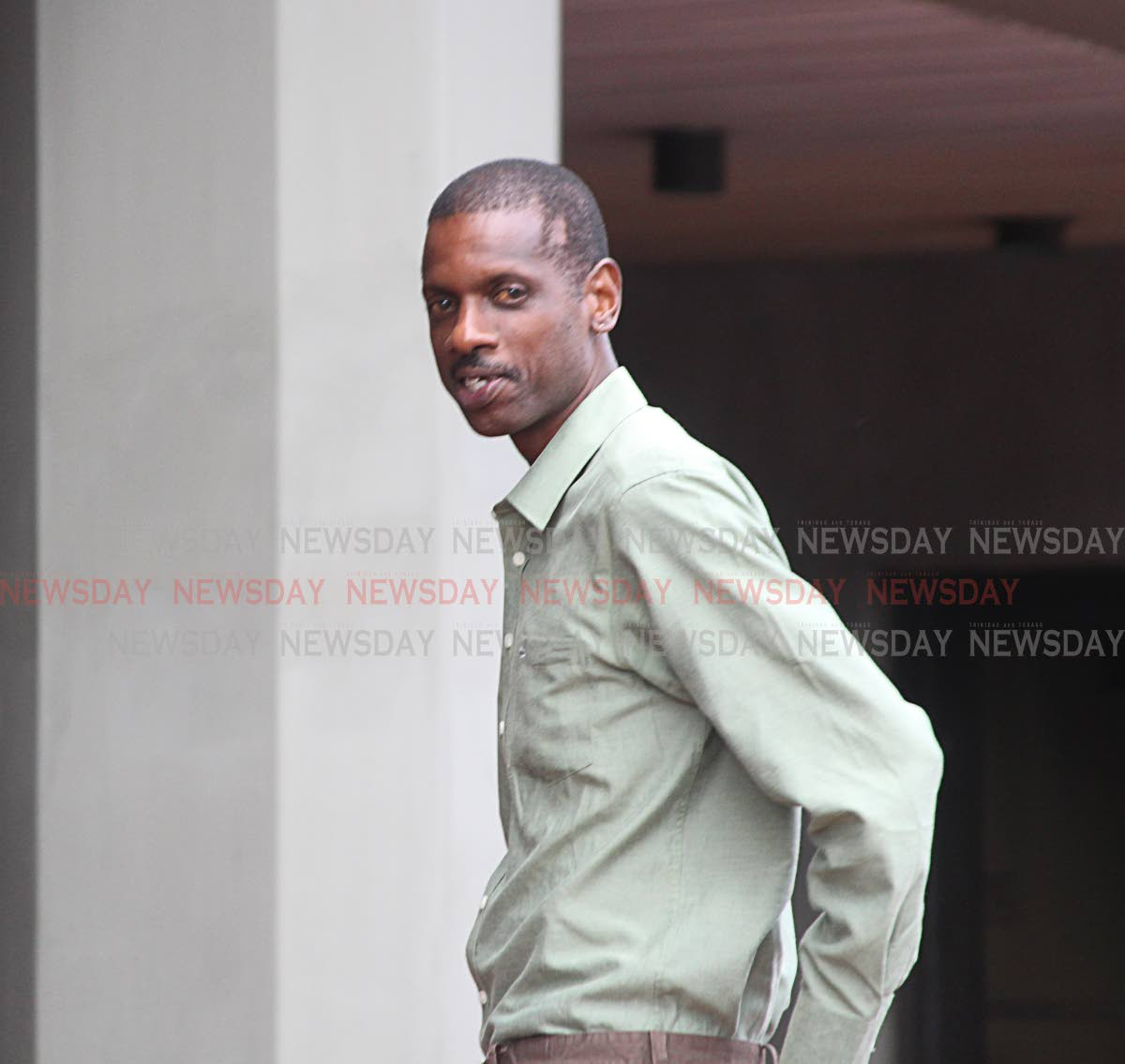 Garth Richards leaving the Hall of Justice yesterday. Photo by Enrique Assoon.