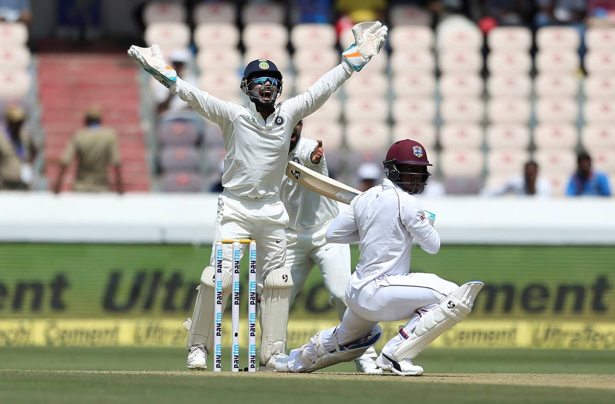 Indian wicketkeeper Rishabh Pant successfully appeals for the dismissal of West Indies' player Shimron Hetmyer, bowled by Kuldeep Yadav, during the first day of the second cricket Test match between India and West Indies in Hyderabad, India, on Friday. India won the Test series 2-0.