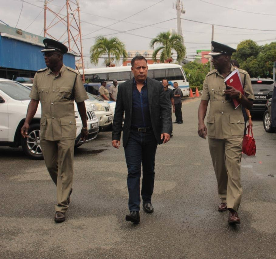 Police Commissioner Gary Griffith, centre, is flanked by acting Senior Superintendent Jeffrey George, left, and Assistant Senior Superintendent Sterling Roberts during a tour of the Scarborough Police Station on October 5. PHOTO BY TTPS