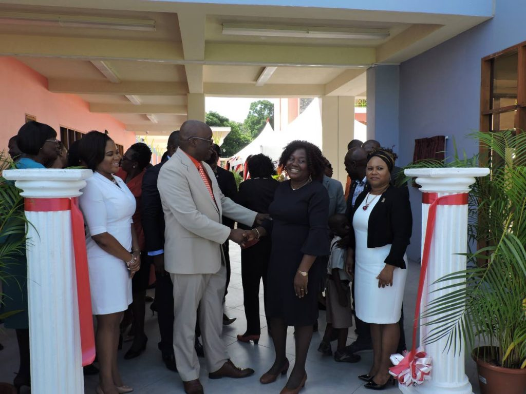 THA Chief Secretary and Secretary of Education Kelvin Charles greets acting Principal Patricia Wafe during the commissioning of the Scarborough Roman Catholic School at Smithfield Road on August 29. At left is Sports Minister and MP for Tobago West Shamfa Cudjoe, whileTHA's Presiding Officer Denise Tsoiafatt Angus looks on at right.