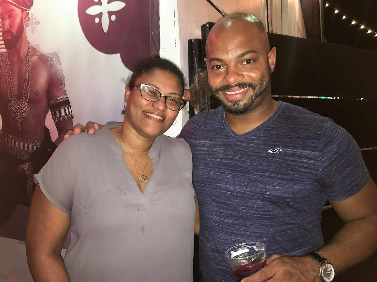 Bouj founder Keith Francois  after a game of cards  with Marsha Gill.