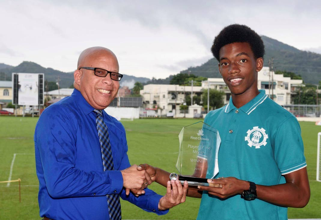 First Citizens Senior Account Manager, Commercial Business Centre, Reynold Thomas (left) presents the First Citizens September Player of the Month Award to Josiah King of Carapichaima East Secondary.