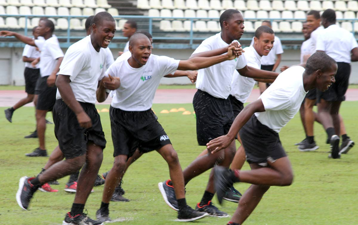 Youths from the MiLAT (Military-Led Academic Training) Academy at the final day of the US embassy's Sport Diplomacy Soccer AssisTT programme,yesterday, at the Larry Gomes Stadium, Arima.  Photo: Roger Jacob