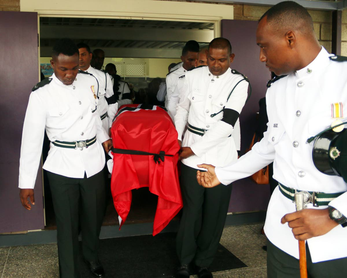 Prisons officers carry the casket of prison officer Darren Francis at his funeral service yesterday.