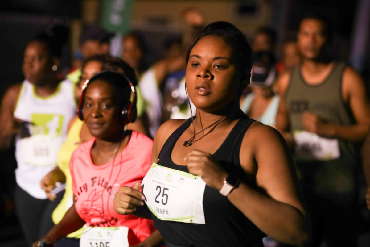 Minister of Sport and Youth Affairs Shamfa Cudjoe takes part in the UWI SPEC International Half Marathon, on Sunday.