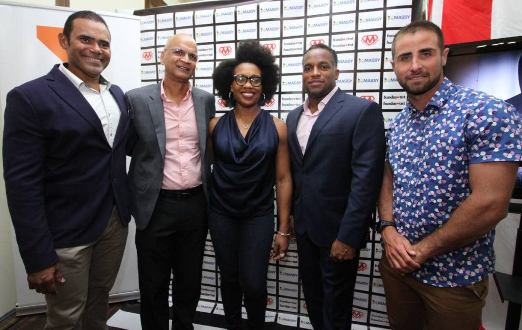 (Left to right) Michael Phillip of Phillip Promotions, director of Massy Foundation Earl Boodasingh, shot putter Cleopatra Borel, Olympic medallist Ato Boldon and Andrew Lewis take time out for a photo at the launch of the 'Icons of TT' motivational video, at Harts Mas Camp, woodbrook, on Tuesday.