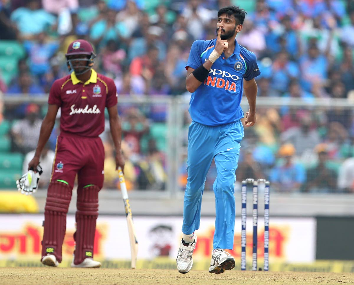 India's Khaleel Ahmed (right) celebrates the dismissal of West Indies' captain Jason Holder during the fifth ODI yesterday. AP PHOTO
