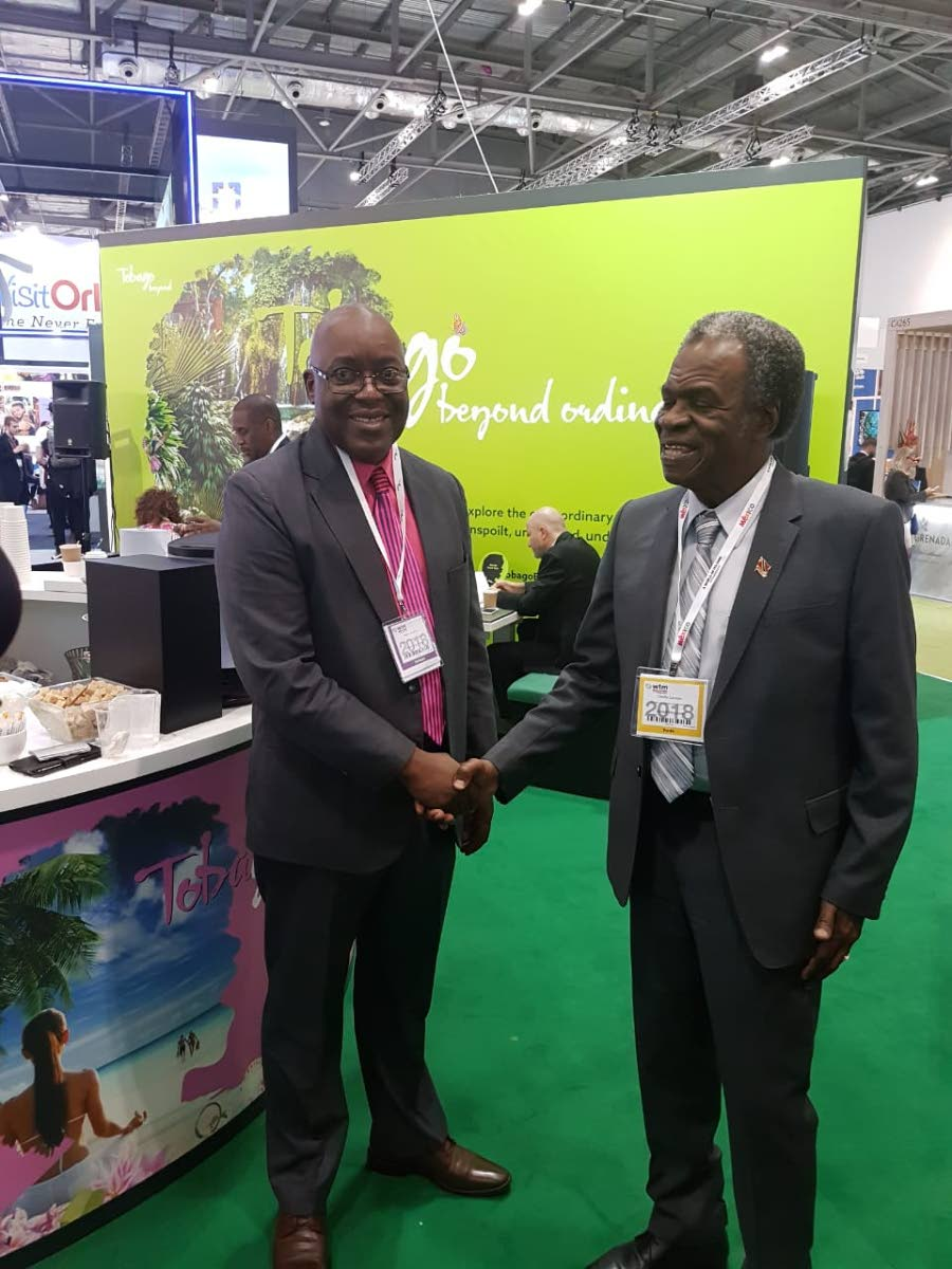 THA Chief Secretary Kelvin Charles, left, greets his predecessor Orville London, High Commissioner to the United Kingdom, at the World Travel Market, which is currently underway in the UK.
