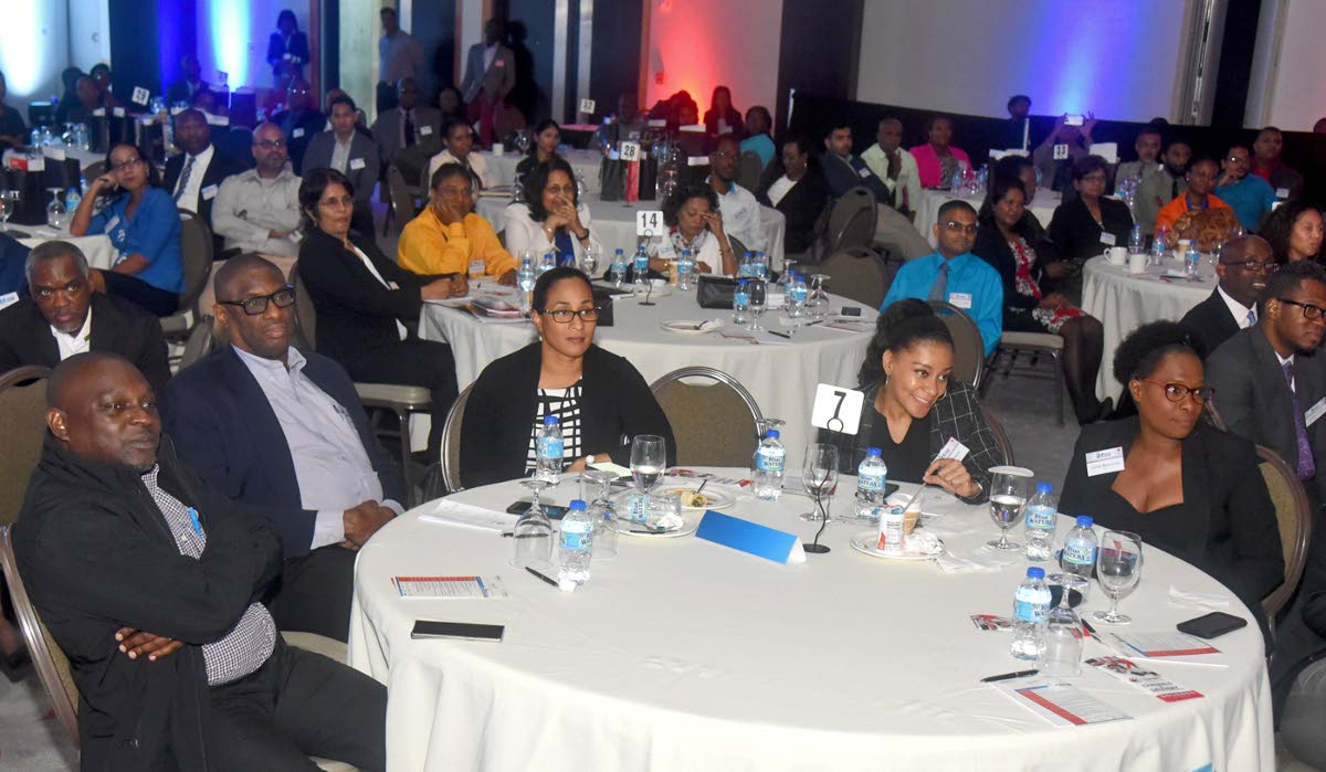 Cross-section of ICT professionals listen to a presentation at iGovTT's ICT Business Symposium at the Hyatt Regency, recently.