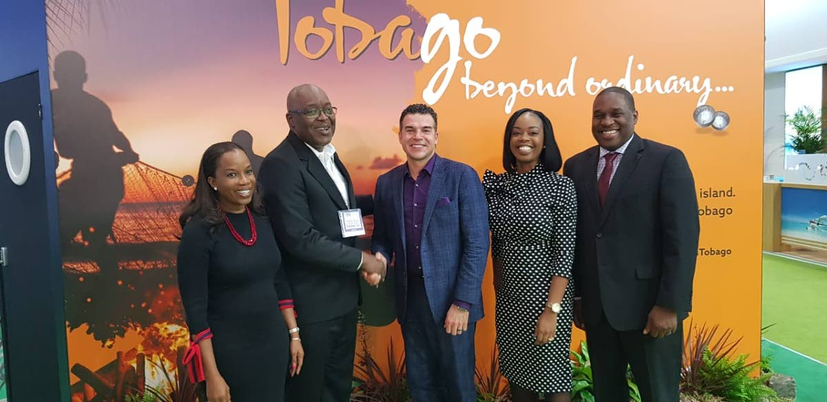 Dr Sherma Roberts, Chairman of Tobago Tourism Agency Ltd (TTAL), left, smiles as Chief Secretary Kelvin Charles, second from left, shakes the hand of Eric Rodriguez, Executive Vice President of Partner Development Tour Operations, Sunwing, as Tourism Secretary Nadine Stewart-Phillips, second from right, and Louis Lewis, CEO of TTAL look on at World Travel Market on Tuesday in London.