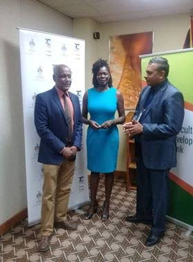 CONFERENCE CHAT: University of the West Indies (UWI) Dean of Faculty of Food and Agriculture Dr Wayne Ganpat (left) chats with UWI lecturer human nutrition and dietetics Dr Marquitta Webb (centre) and Agricultural Development Bank (ADB) CEO Sheivan Ramnath following a media conference Wednesday at ADB's offices, Port of Spain.