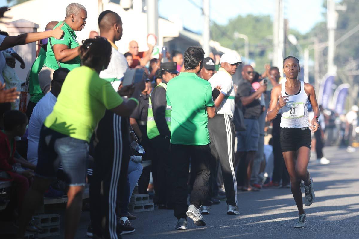 SAMANTHA SHUKLA crosses the finish line at the University of the West Indies' (UWI) SPEC International Half Marathon on October 28.