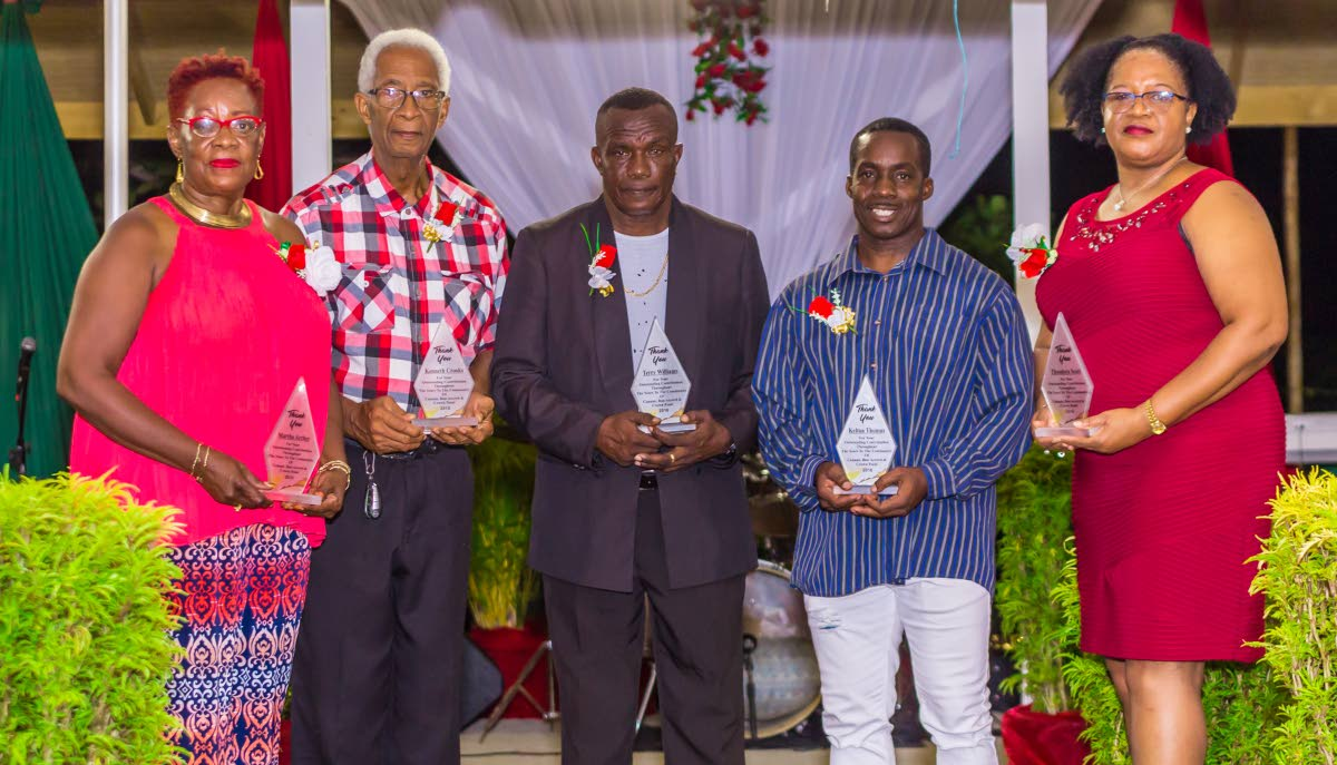 PROUD BUNCH: (From left) Marther Archer, Kennett Crooks, Terry Williams, Kerton Thomas and Theodora Scott received awards as sport educators at the Canaan/Bon Accord community awards.