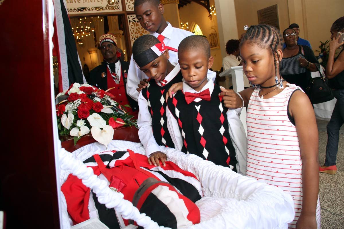 BYE GRANDPA: (from left) Zaid, Zakr, Zair and Zariah say farewell to their grandfather Winston Scarborough - The Original De Fosto Himself at the RC Cathedral of the Immaculate Conception yesterday.   PHOTO BY SUREASH CHOLAI