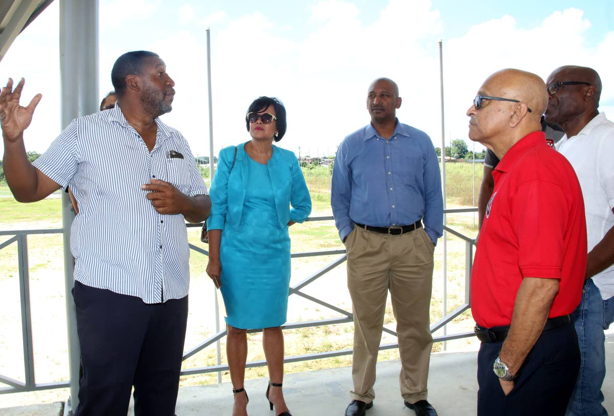 TTFA president David John-Williams (left) speaks to representatives from local sporting bodies, including  Dr Patricia Butcher (netball), Robert Farrier (cycling) and Dudnath Ramkessoon (cricket), during yesterday's tour of the Home of Football.
