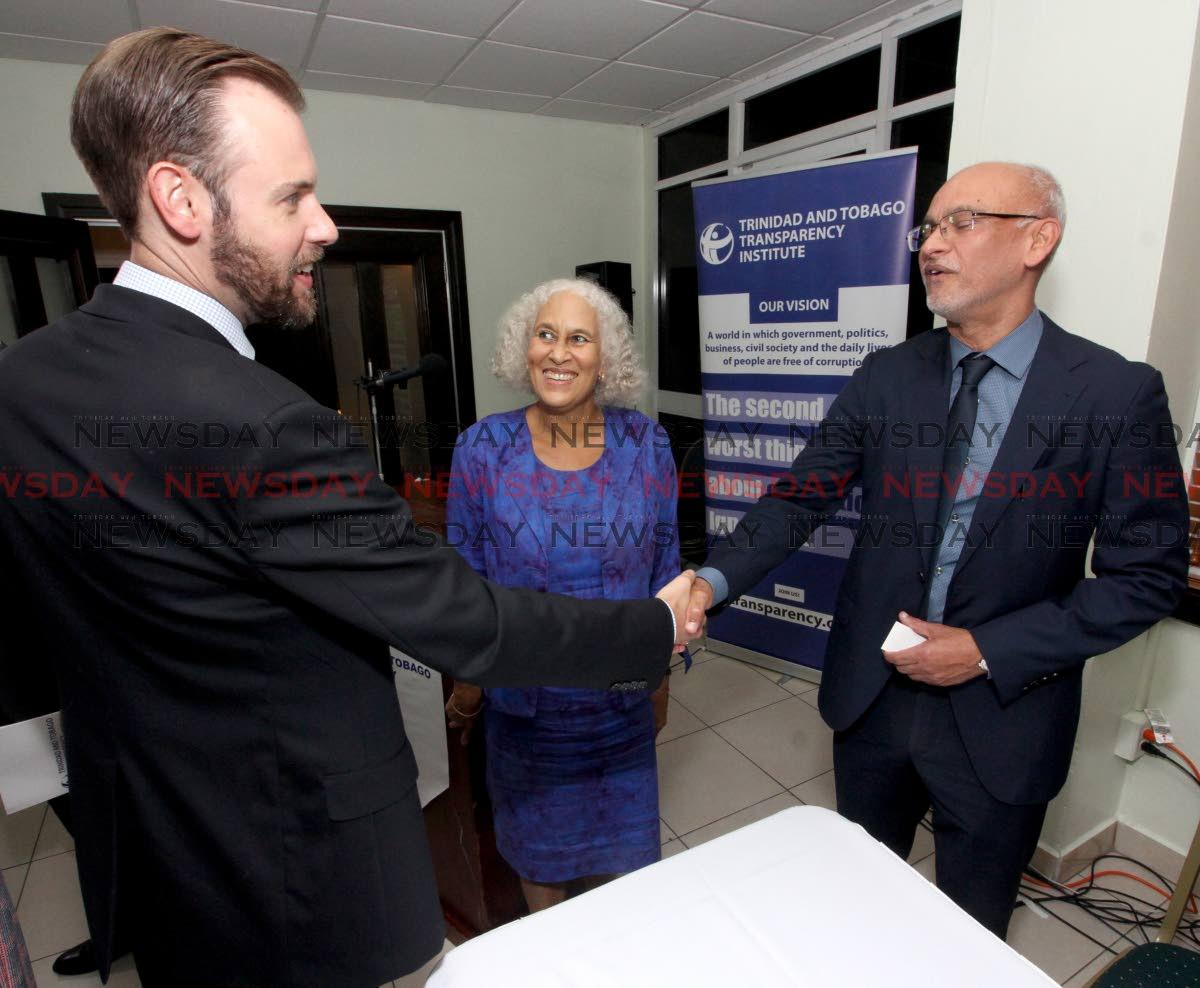 EBC chairman Mark Ramkerrysingh greets Matthew Ciesielski, economic officer, US Embassy alongside Susan Gordon, TTTI secretary and director during the AGM of the TT Transparency Institute, Queen's Park Oval, Port of Spain last Thursday. PHOTO BY ROGER JACOB