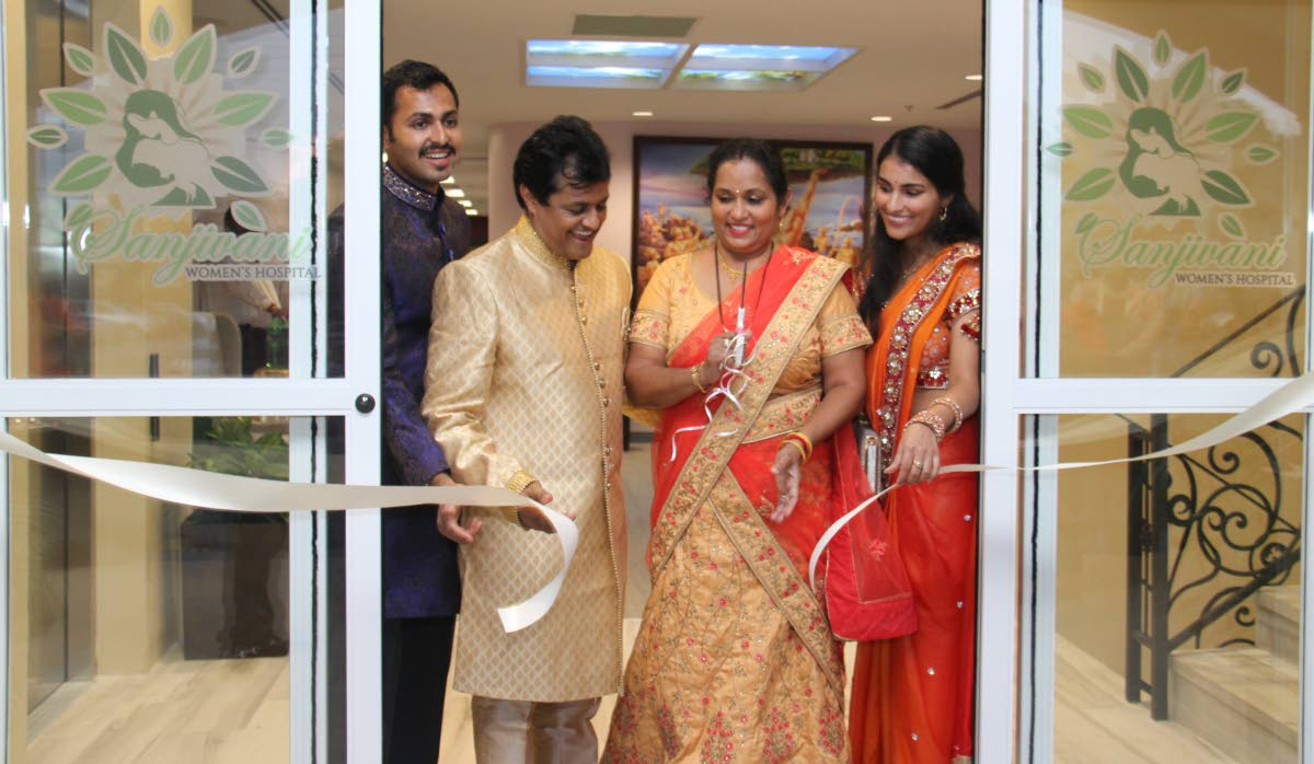 Dr. Prakashbhan Persad and his wife, Sashtri cut the ribbon to officially open the Sanjivani Women's Hospital, assisted by their children, Dr Vashisht Persad and Dr Gyotti Persad.