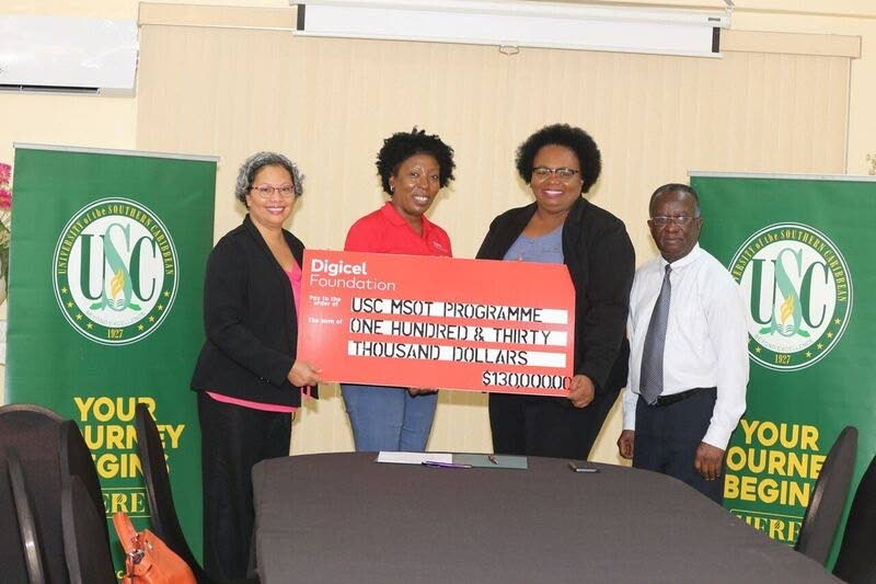 Natalie-Anne De Silva, Digicel Foundation project officer, second from left, presents the commitment of funds to representatives of the University of the Southern Caribbean Dr Lesley Garcia OTDMS, director MSOT Programme USC; Dr Wanda Chesney, asst provost, USC and Dr Emmanuel Antwi, Ag dean of School of Science, Technology and Allied Health.