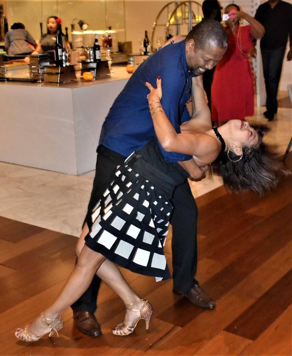 Marisa Hernandez and dance co-ordinator Wayne Sargent show off their moves.