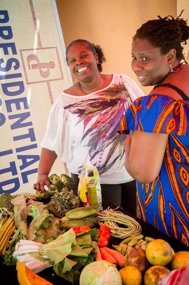 Jennifer Regis-Thomas (left), founder of the Promise Basket, interacts with a customer.