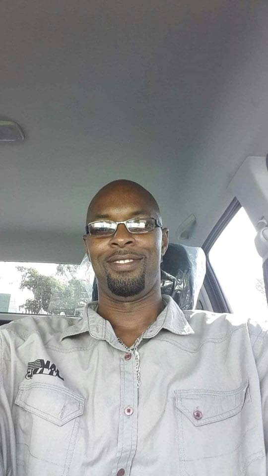 Dwayne King was shot several times by assailtants as he drove his Nissan Tiida near Sea Lots yesterday.