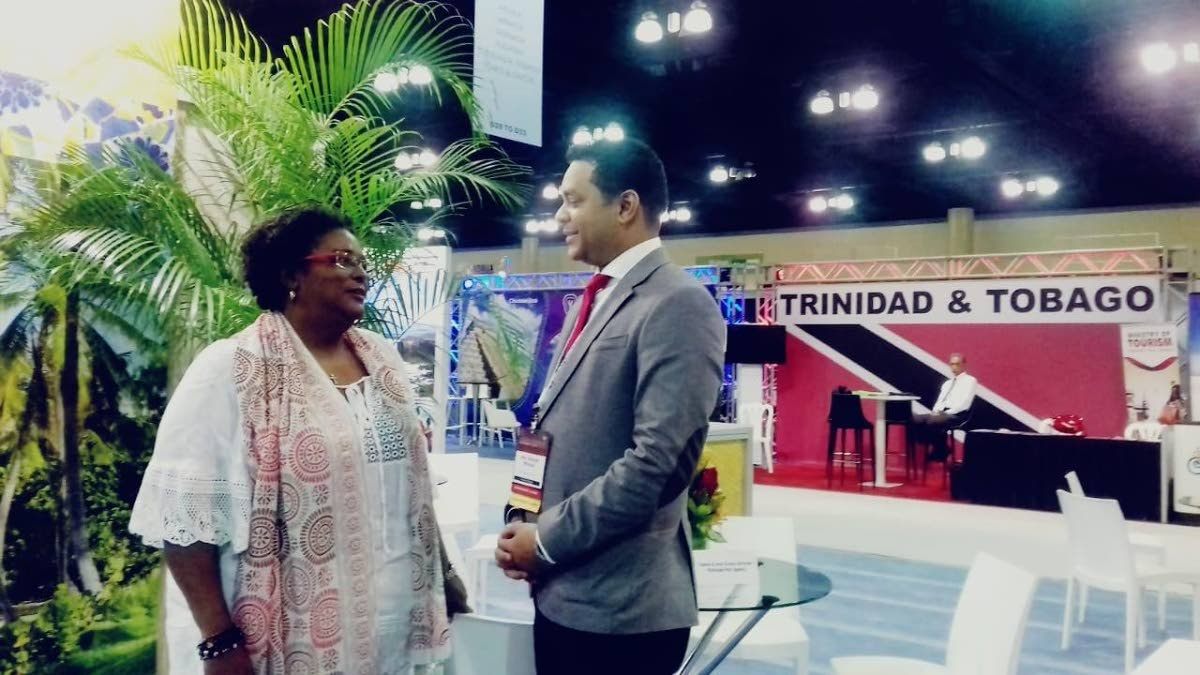 Tourism Minister Randall Mitchell and Barbados Prime Minister Mia Mottley speak at the FCCA Trade Show in Puerto Rico. Photo courtesy Ministry of Tourism.